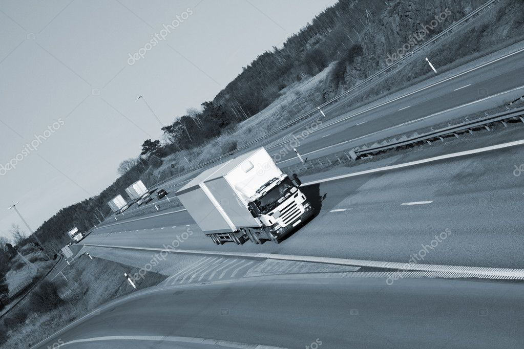 Truck driving on scenic freeway