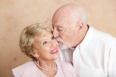 Senior Couple - Kiss on the Cheek