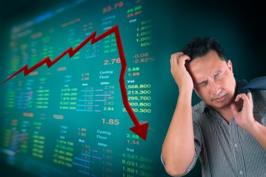 Business man stress about falling stock market