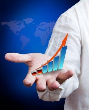 Business man holding growth graph with world map background