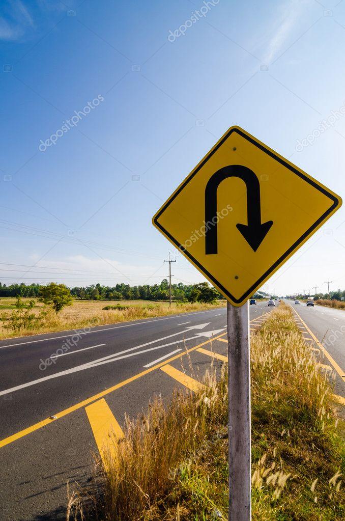 U-turn symbol Road in rustic city