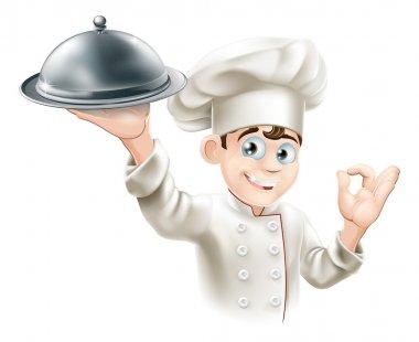 Happy chef holding platter