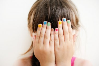 Little girl with hands covering her eyes