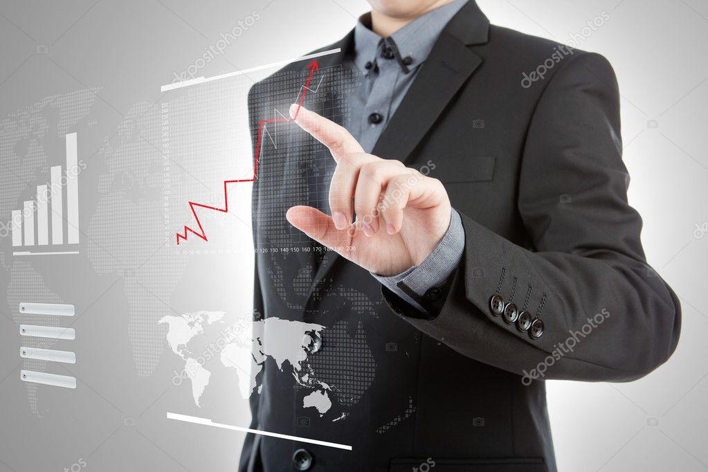 Business man pressing high tech type of modern graph on a virtua