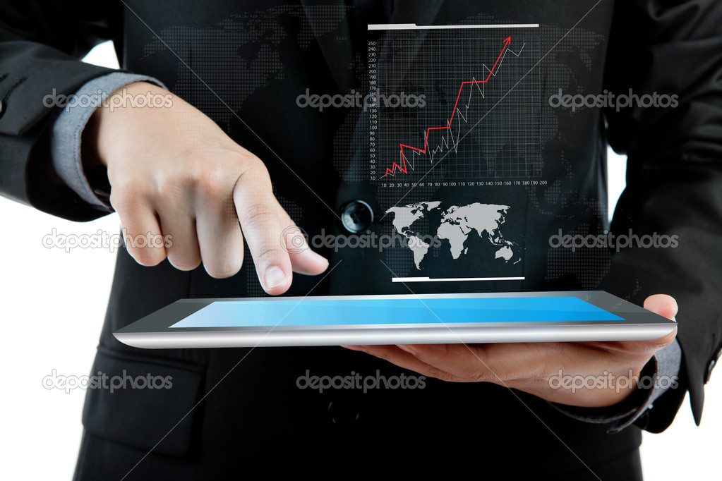 Business man holding the modern digital tablet pc with success g