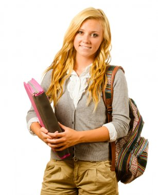 Portrait of happy smiling teenage schoolgirl with backpack and binder isolated on white