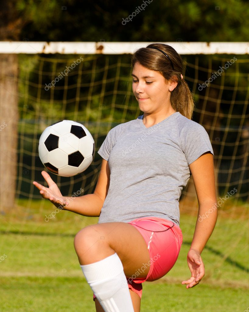 Teen Girl Juggling Soccer Ball With Her Knees  Stock Photo  Robhainer 12362388-8963