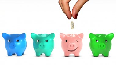 Woman's hand choosing a piggy bank and giving it a piece of money