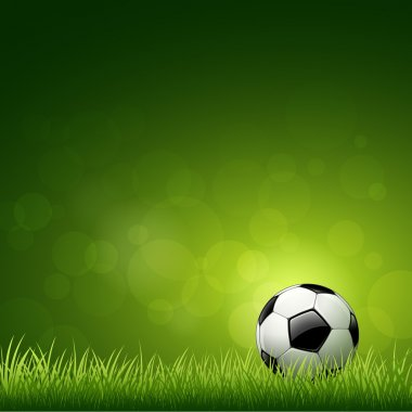 Soccer ball design on green grass background