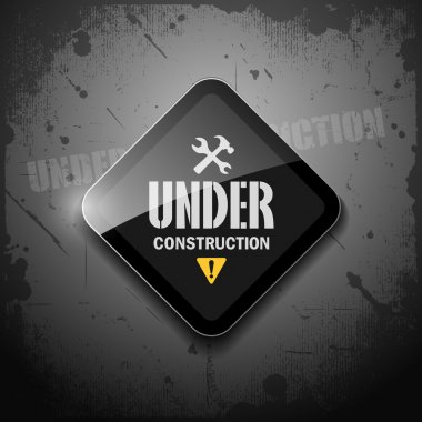 Under construction sign on grunge background