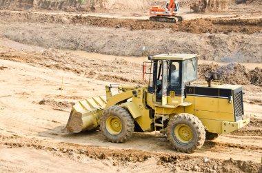 Heavy excavator loader at soil