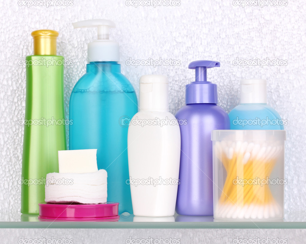 Shelf with cosmetics and toiletries in bathroom — Stock Photo ...