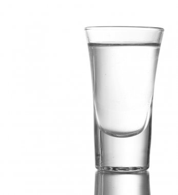 Glass of vodka isolated on white