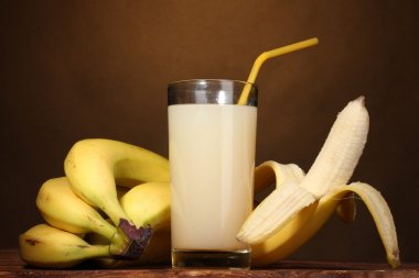 Banana juice with bananas on brown