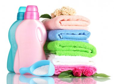 Detergent with washing powder and towels isolated on white