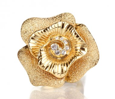 Golden ring with gold flower and clear crystals isolated on white