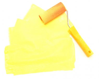 Paint roller with yellow paint isolated on white
