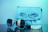 Womens fashion accessories on bright colorful background