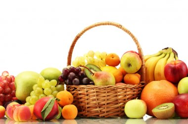 Assortment of exotic fruits in basket isolated on white