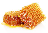 Fotografie Sweet honeycombs with honey, isolated on white