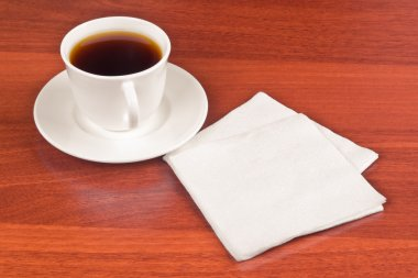 Cup of coffee and napkin