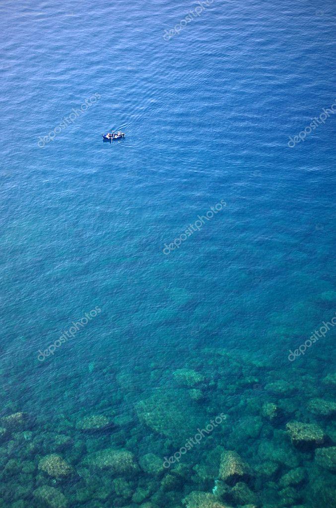 Boat in clear water