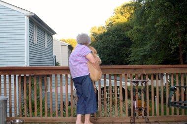 Senior Woman Holding Puppy Horizontal