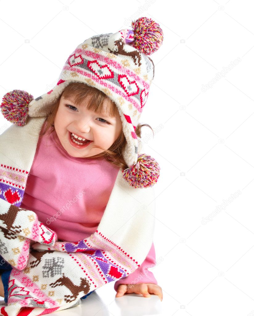 Beautiful girl in the hat on a white background