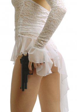 Woman in white with gun, side view