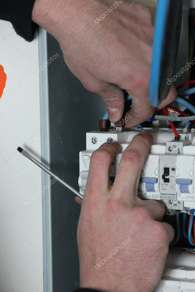 Electrician wiring a fuse box — Stock Photo © photography33 #11511999