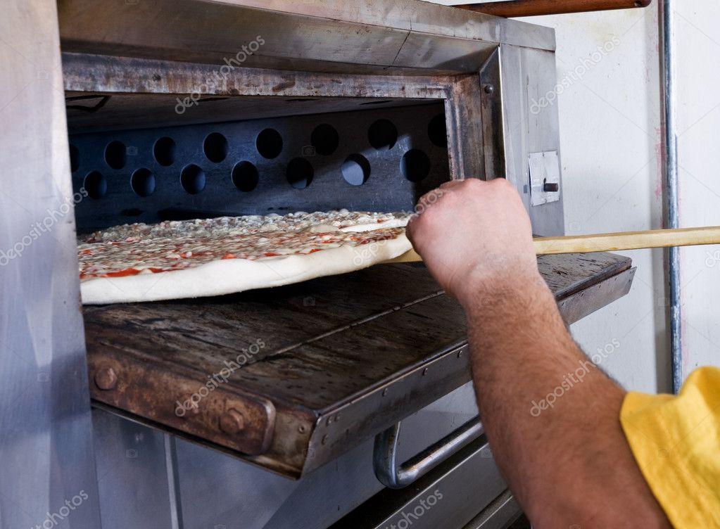 Pizza Küche Pizza Backen — Stockfoto © jimdelillo #12416145