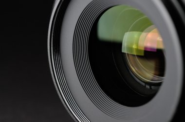 Camera lens close-up on black background stock vector
