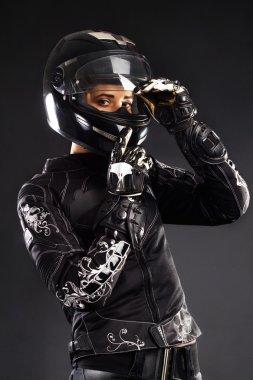 Beautiful biker in black outfit