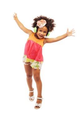 Lovely little girl in headphones having fun
