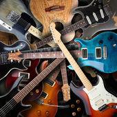 Fotografia sfondo di chitarre elettriche