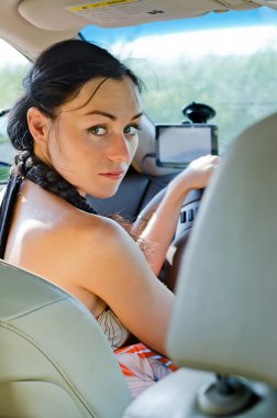 Woman driver looking back
