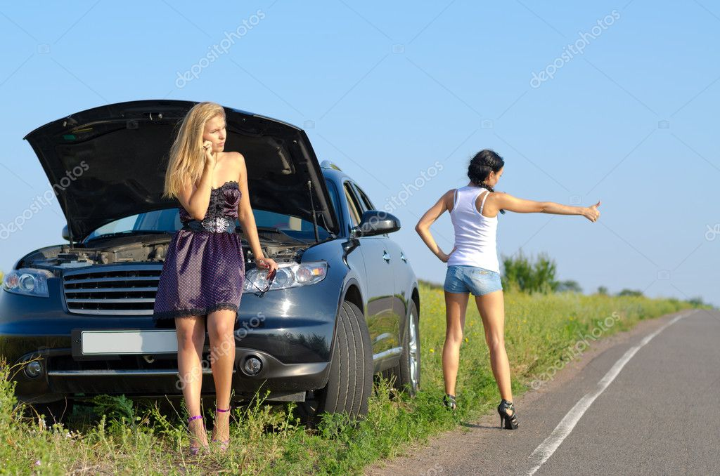 Women with a roadside breakdown