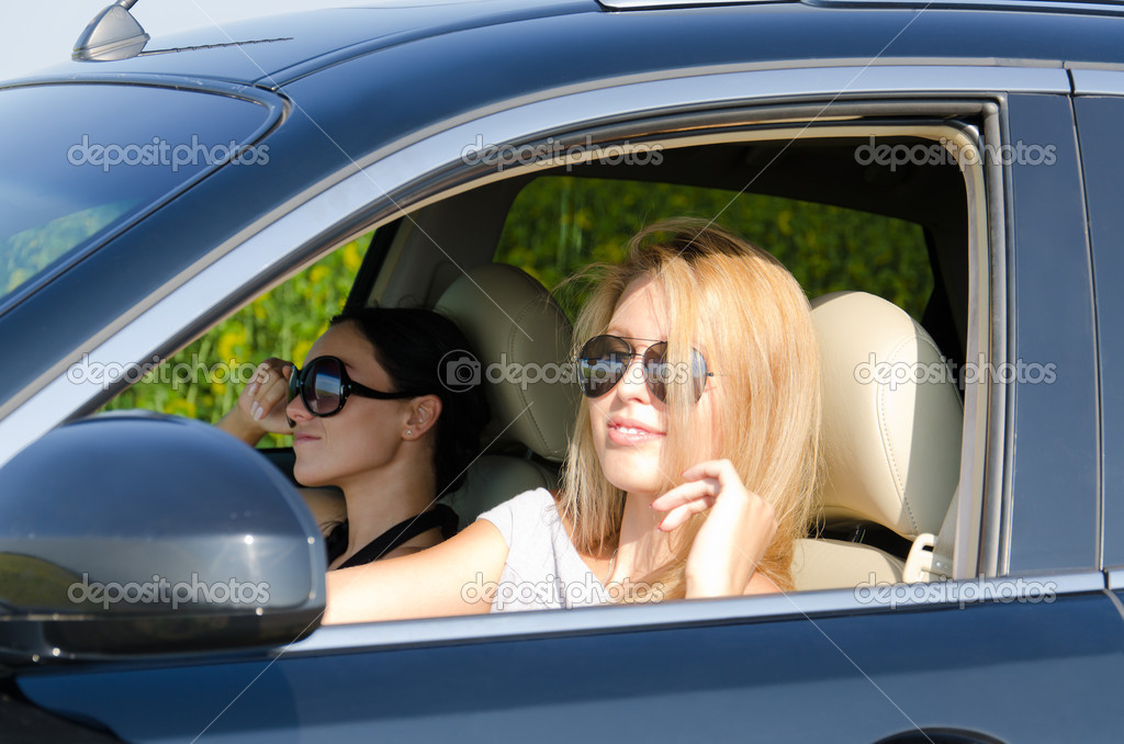 Two women in a luxury car