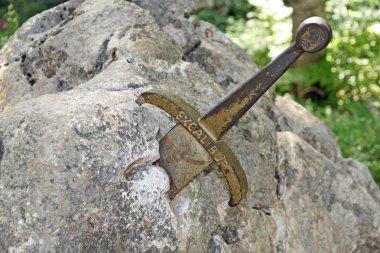 The legendary sword of King Arthur stuck in the rocks