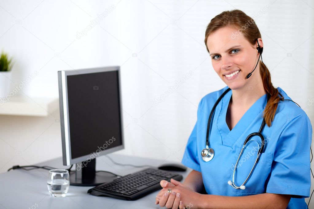 charming female hospital receptionist stock photo