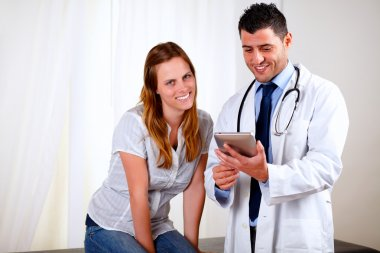 Professional medical doctor with a patient
