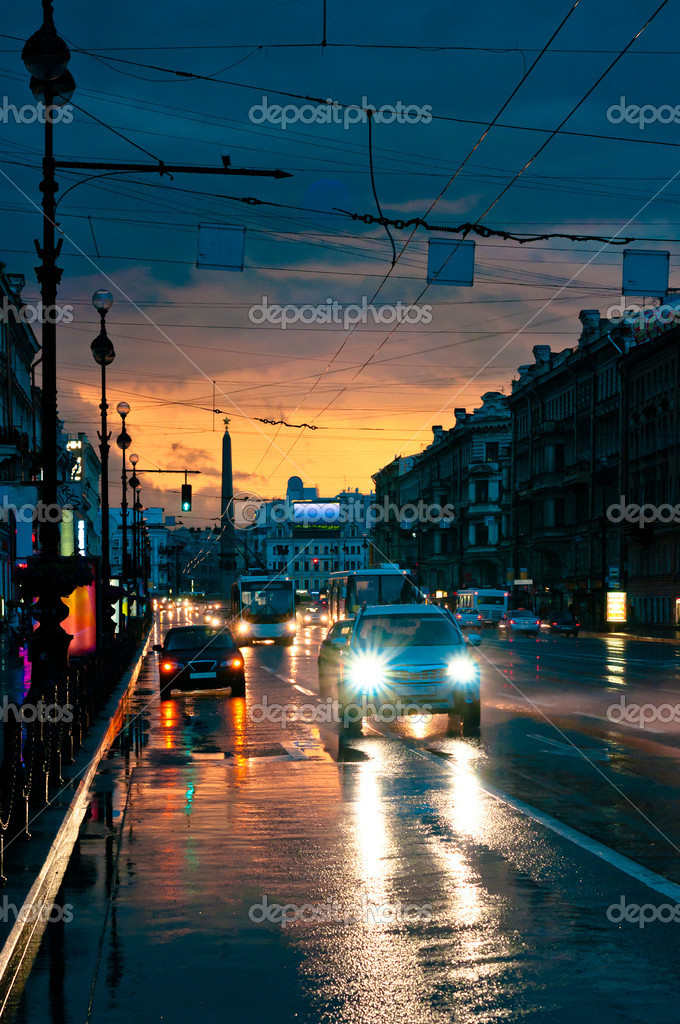 Cars on wet road at night