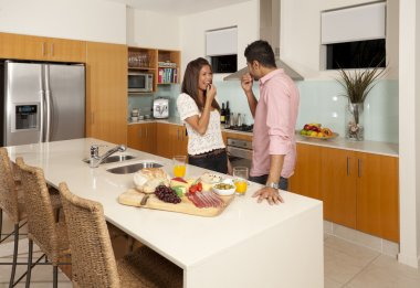 Young couple in modern kitchen