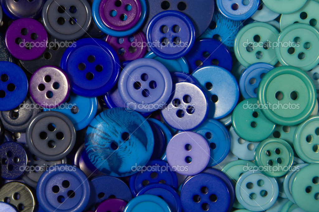 Blue buttons, small and large as a background texture.