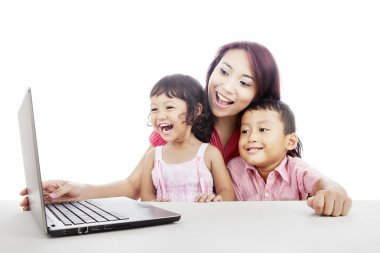 Happy family surfing internet