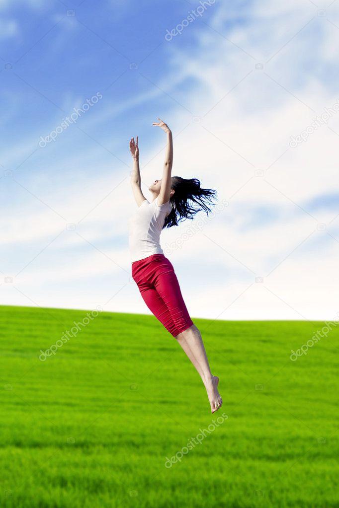 Woman dancing in nature