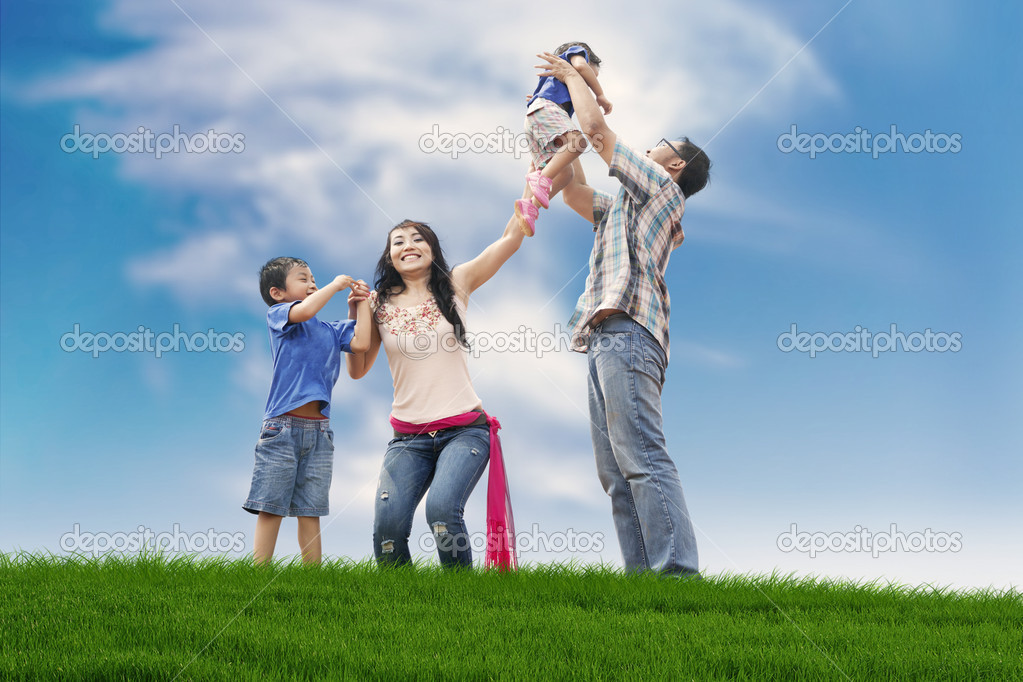 Happy family on the meadow