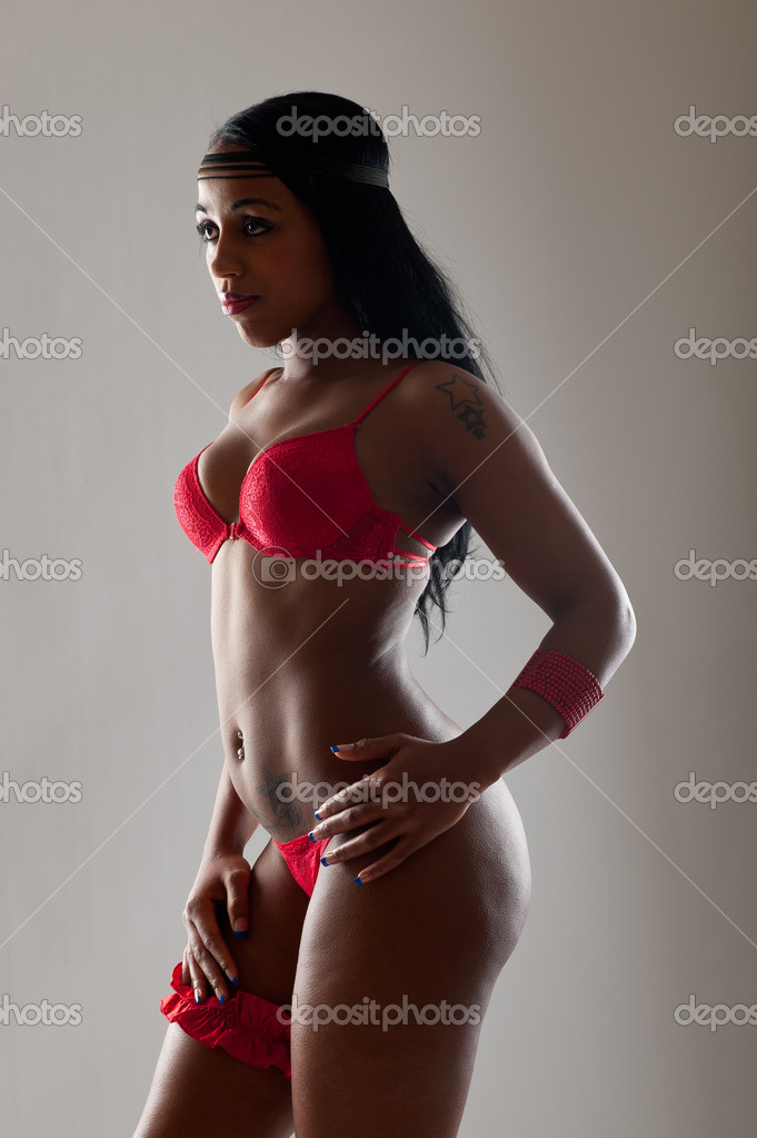 Black woman standing in lingerie