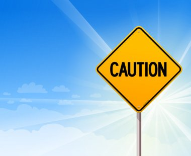 Caution on blue sky background