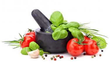Mortar with basil, garlic, tomatoes and pepper
